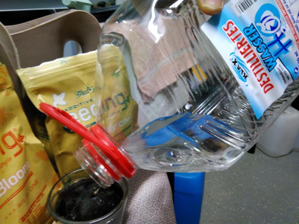 e_distilled water and stir well.jpg
